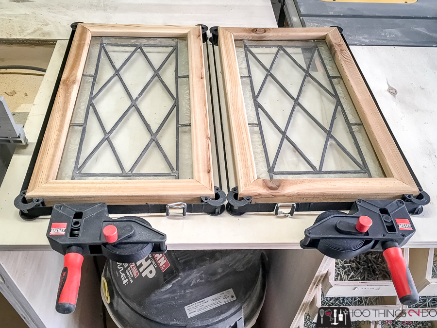 stained glass window panels in strap clamps