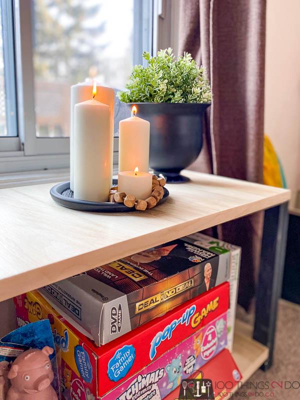 candles on low bookshelf