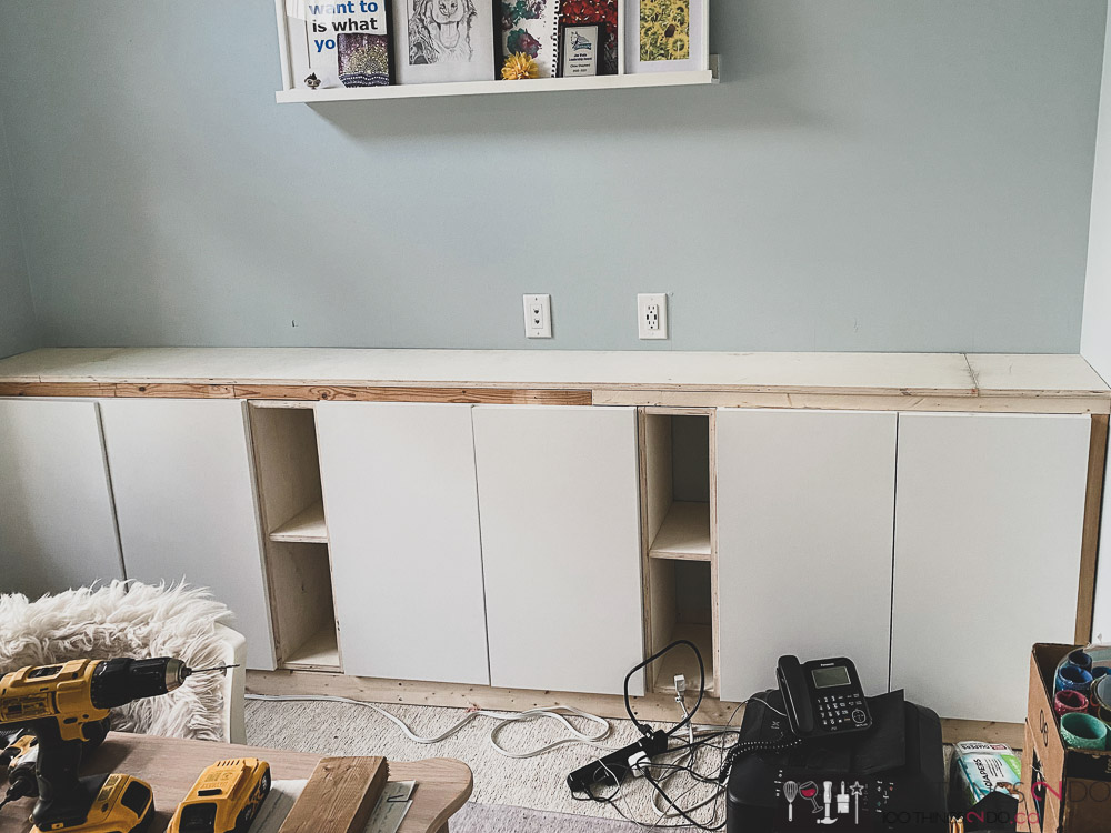 finished framing the base cabinets of office built-ins