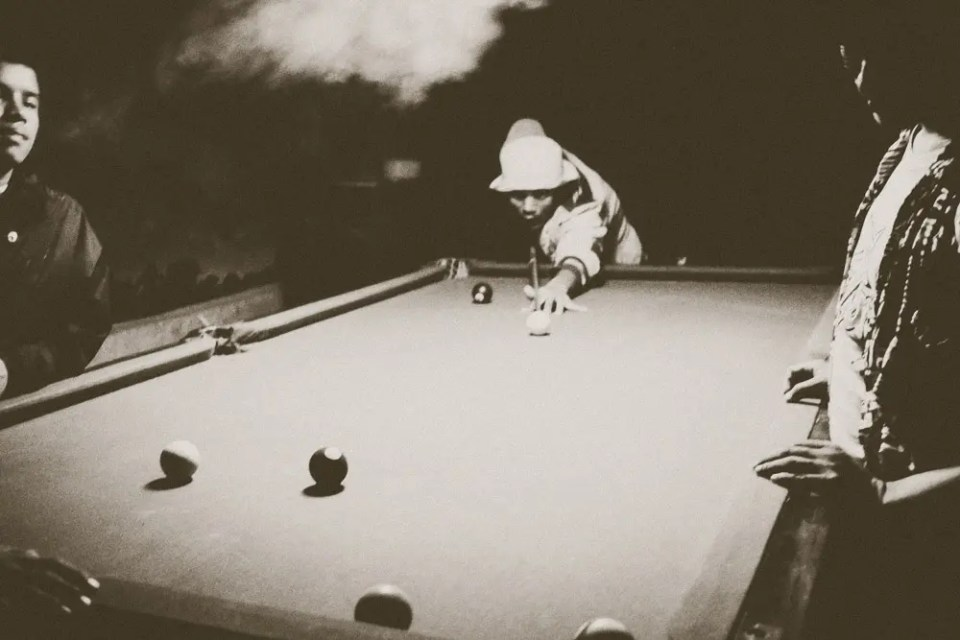 Playing pool and smoking marijuana