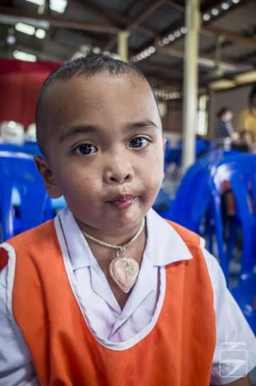 Kindergarten Boy Wearing Amulet