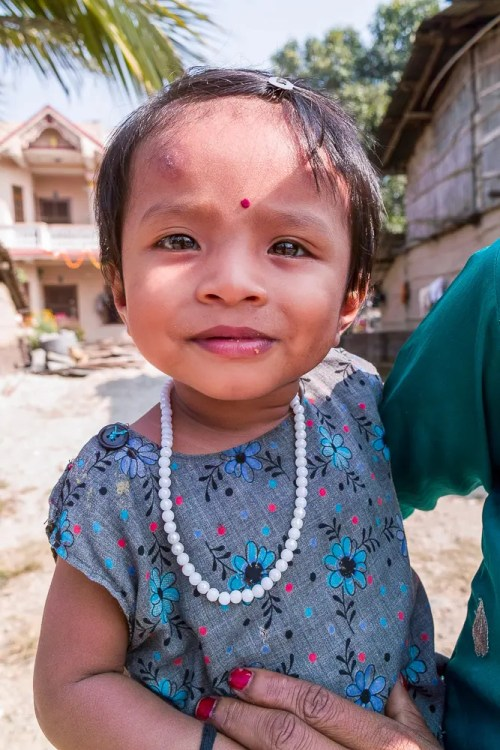 Little girl with necklace