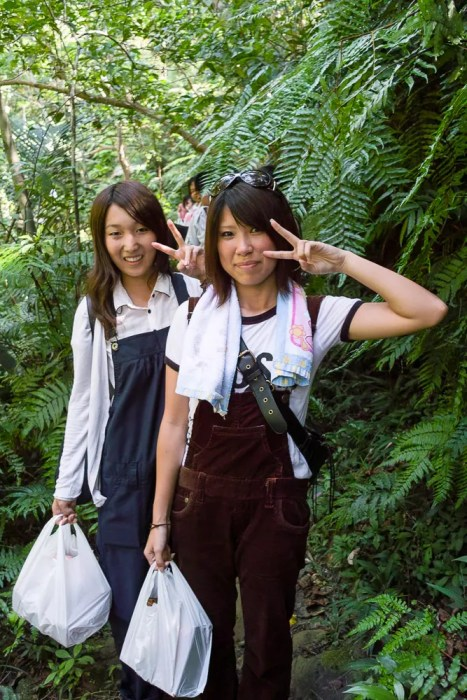 Schoolgirls hiking in Iriomote