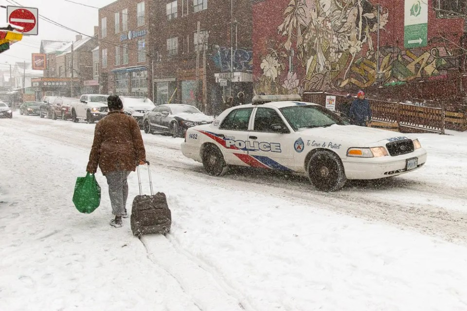 Toronto winter storm - police car in Kensington Market
