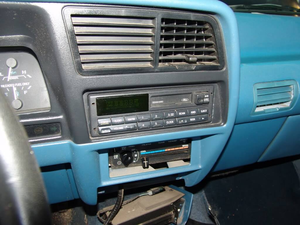I was going to remove the radio using the u shaped tool i am holding but it would not budge so i just left it in and pulled the dash trim panel