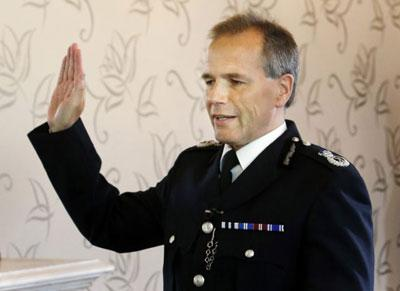 Unelected and unaccountable Generalissimo Stephen House giving a Red hand salute or maybe taking oath to Betty Battenburg.