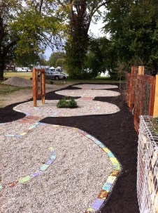 West Louisville Women's Coalition labyrinth and photo.