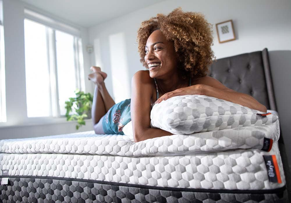 Layla Mattress Review, woman on a layla mattress