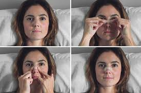woman in bed applying nose strips