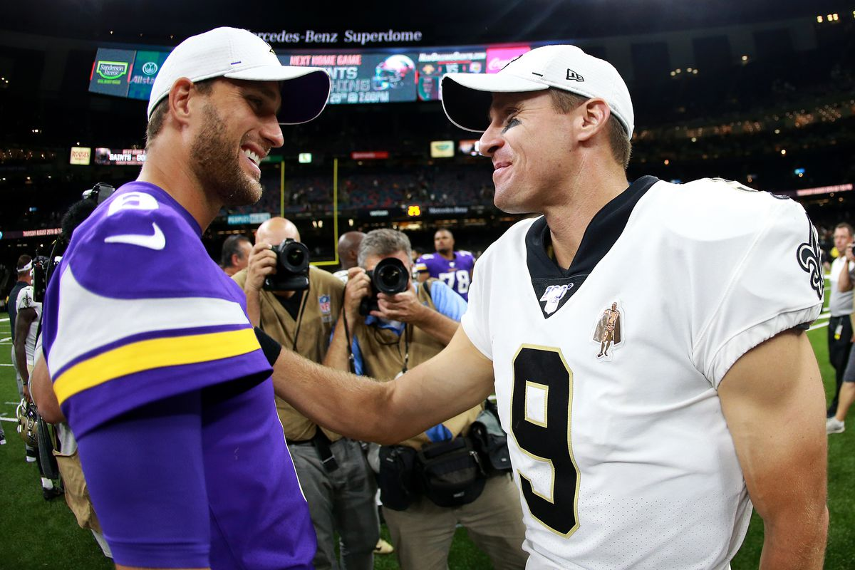 Kirk Cousins shaking hands with Drew Brees