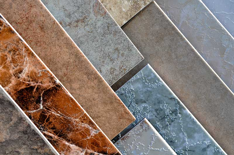 What are some tips for cleaning natural stone tiles?