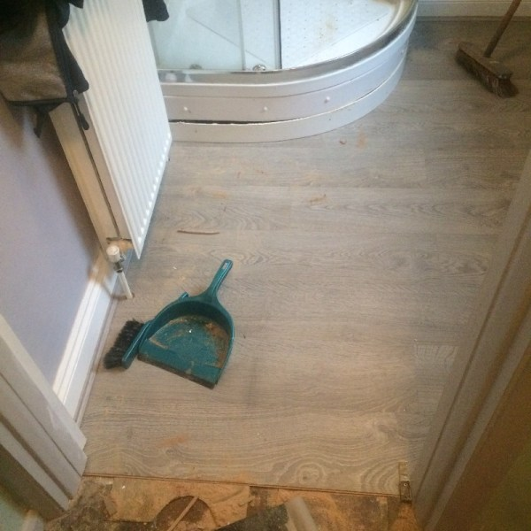 Shower room with laminate flooring installed