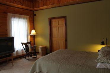 master bedroom 11 ft exposed beam ceiling