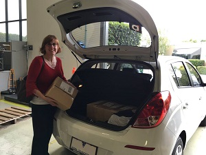 Sue Ellson collecting first books from IngramSpark Printers 18/02/16