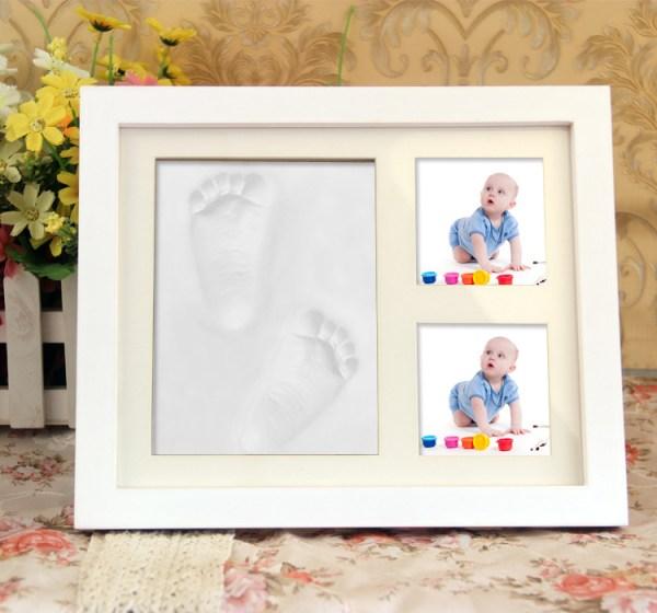 Baby fotolijst met voetafdruk of handafdruk