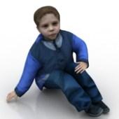 Little Boy Sitting On Floor