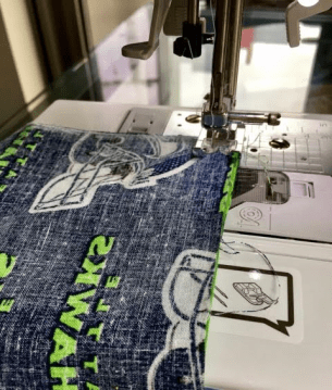 """Line up the fabric so both """"good sides"""" face inward, and sew 3 sides (2 long, 1 short)"""