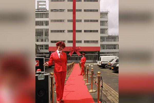 opening - gebouw - pand - kantoor - winkel - bedrijfshal - rode - loper - grootse - strik