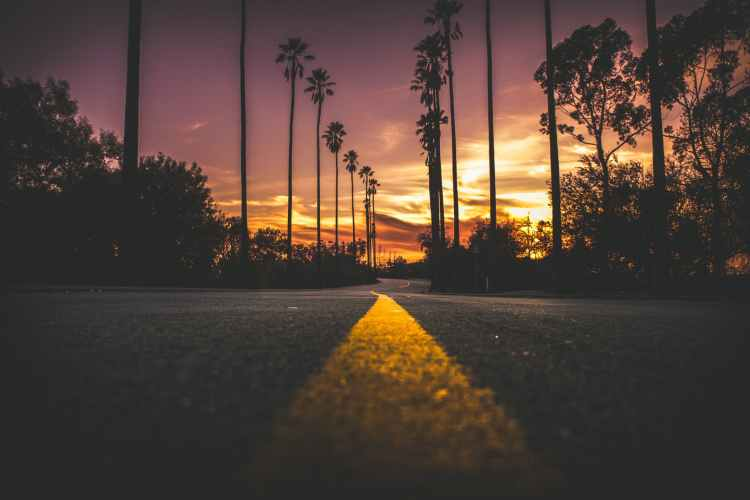 road in city during sunset