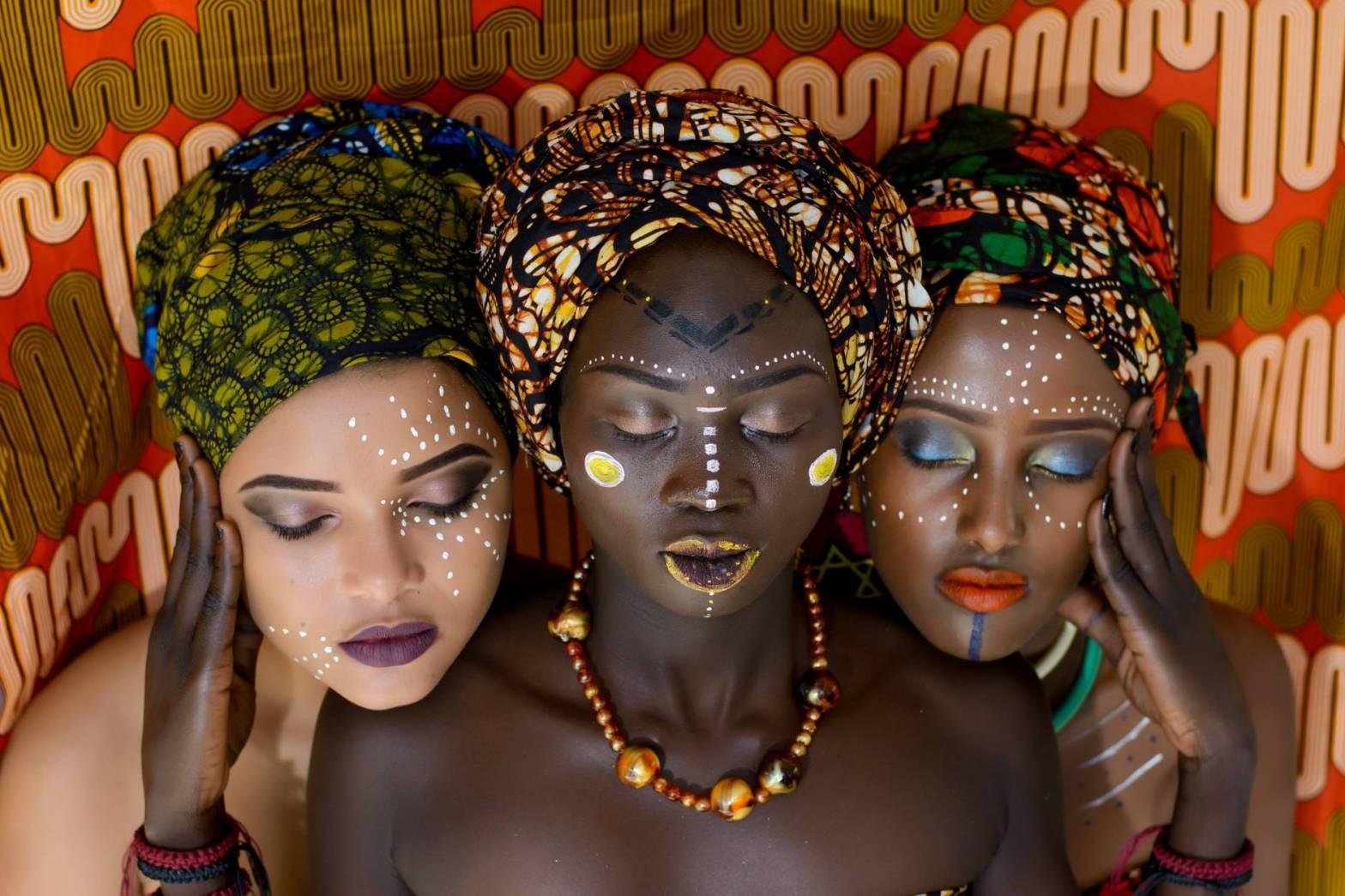 three women wearing turbands