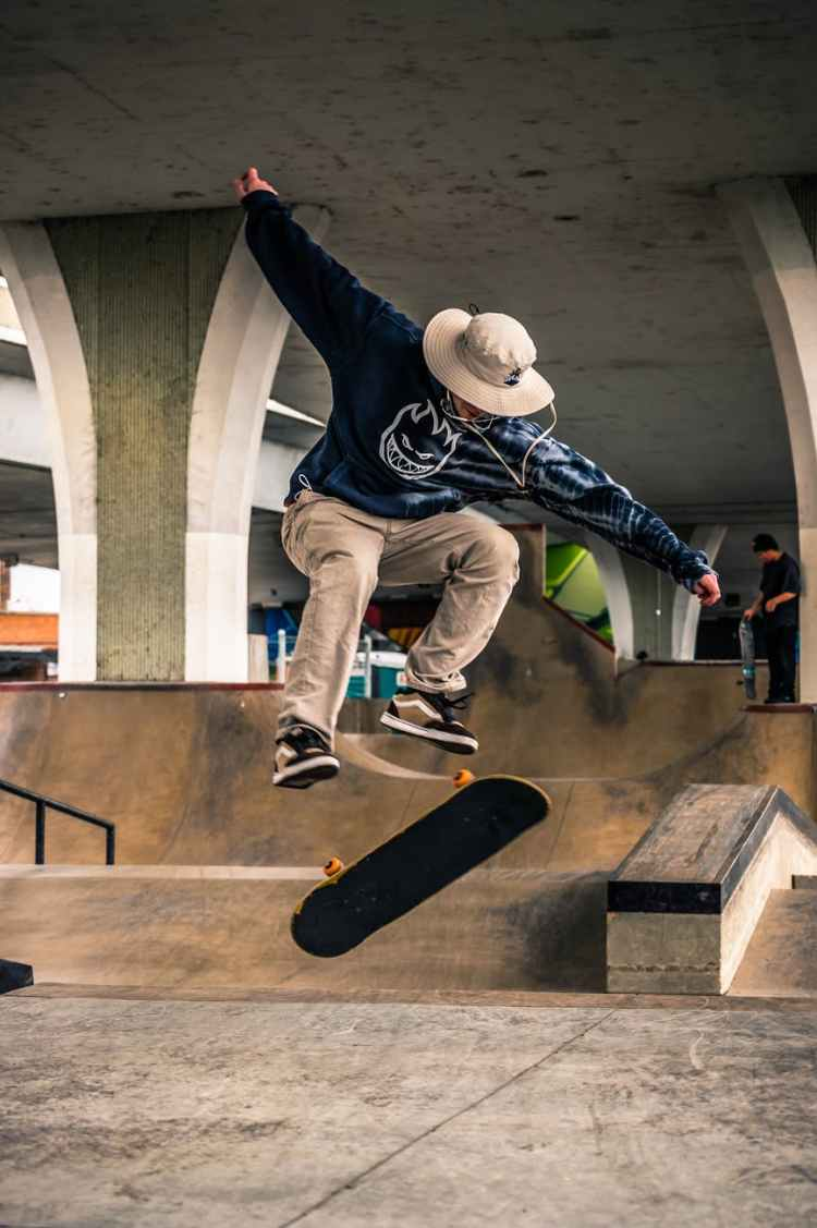 man on mid air performing skateboard trick