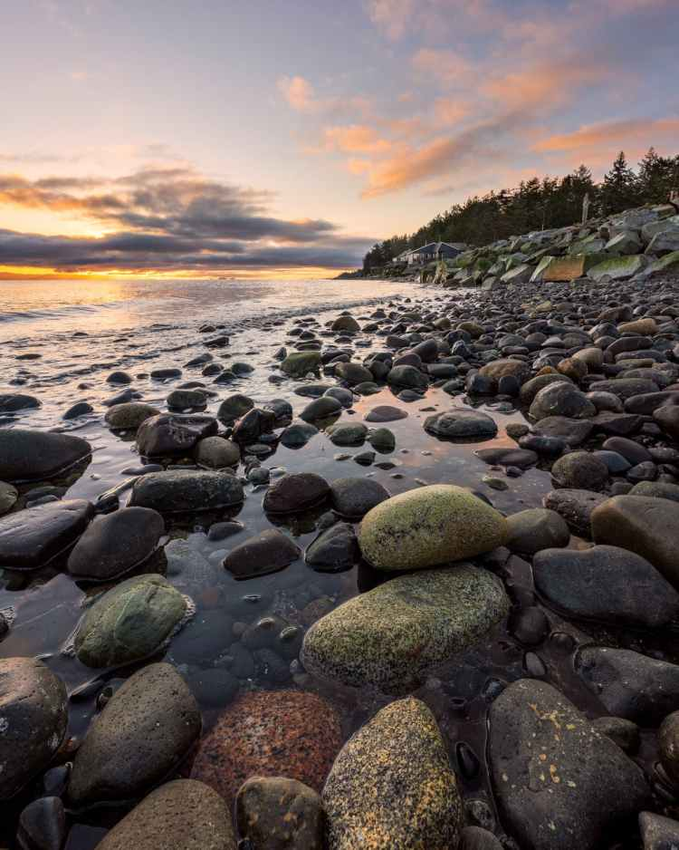 photo of rocky seashore during golden hour