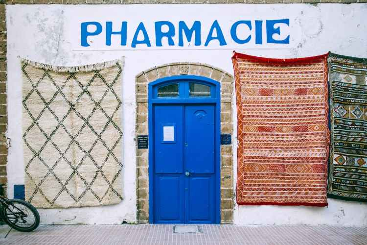 exterior of shabby pharmacy building in mediterranean country