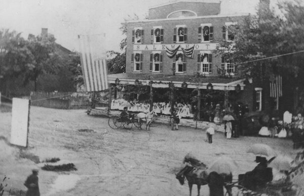 South Main Street showing the Salem Hotel decorated for the arrival of the 123rd Regiment on July 1, 1865.