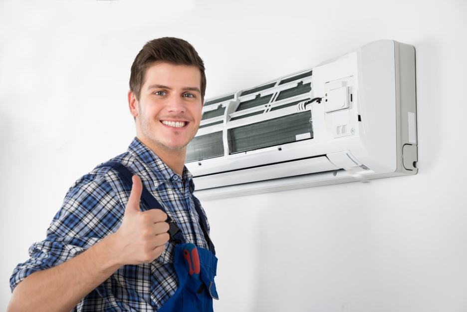 Happy Worker smiling after Servicing A/C