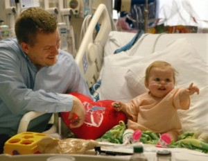 Heart transplant patient Layla Ries and her father, Randall (Photo credit: Ohio.com - See story at http://www.ohio.com/news/break-news/akron-children-s-hospital-joins-with-cleveland-clinic-to-repair-congenital-heart-defects-1.575243)