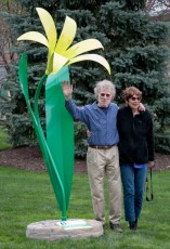 Artists Judith Spater and Stephen Canneto with the  Trout Lily flower after installation at Akron Children's.