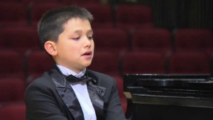 Young classical pianist fights cancer one key at a time