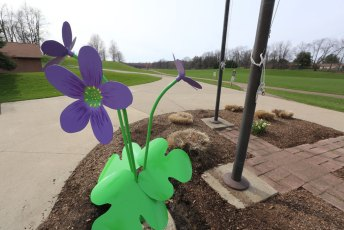 This fun and colorful Round-Lobbed Hepatica sculpture greets families enjoying Boettler Park in Green.