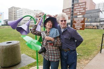 Artists Judith Spater and Stephen Canneto interact with the Virginia Bluebell at Lock 3 in downtown Akron.