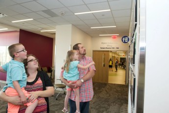 The Wertz family checks out their twins' Wall of Hope display.