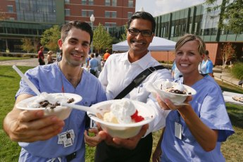 Dr. Ananth Murthy (center) and medical residents Ben Eskenazi and Anna Widmyer enjoy a refreshing ice cream treat