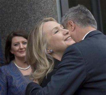 Hillary and Thaci embracing