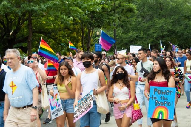 Marchers walk down Connecticut Avenue at D.C.'s Capital Pride (The American Spectator)