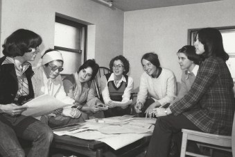 A group of students participate during a meeting of the Women's Law Student Association.