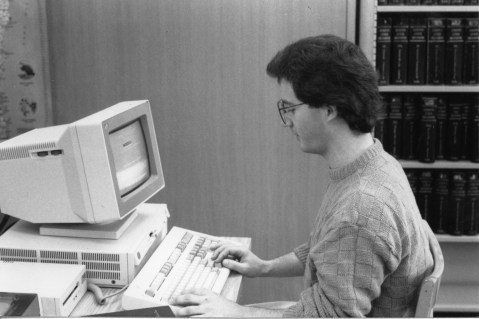 Law student using a library computer