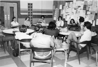 Student Bar Association President Cindra Carson chairs a meeting of the Student Bar Council in the Law School's lounge in 1979.