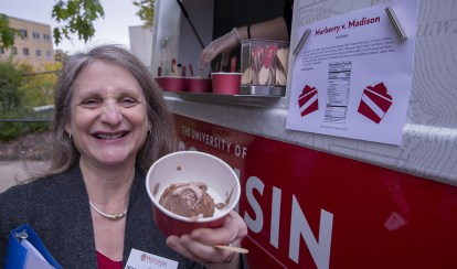 Dean Margaret Raymond shows off UW Law School's 150th anniversary ice cream, Marberry v. Madison.
