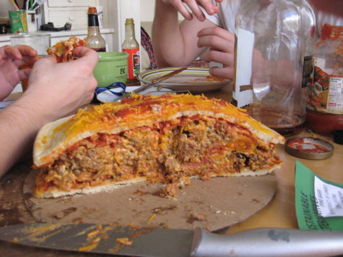 The Widowmaker 1.5 lbs of ground beef, 1 package of bacon, 1 package of italian sausage, 1 box of hot pockets, 1/2 package of fried onion strips between 2 Tombstone Pepperoni Pizzas topped with Velveta Cheese and Marinara Sauce. (Submitted by Chris H)
