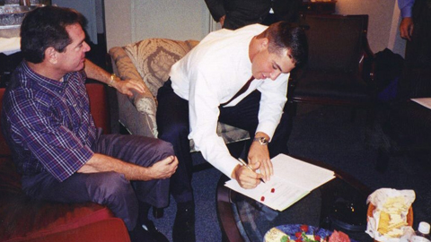 Mark Teixeira signs his first professional contract in 2001 as his father proudly looks on.