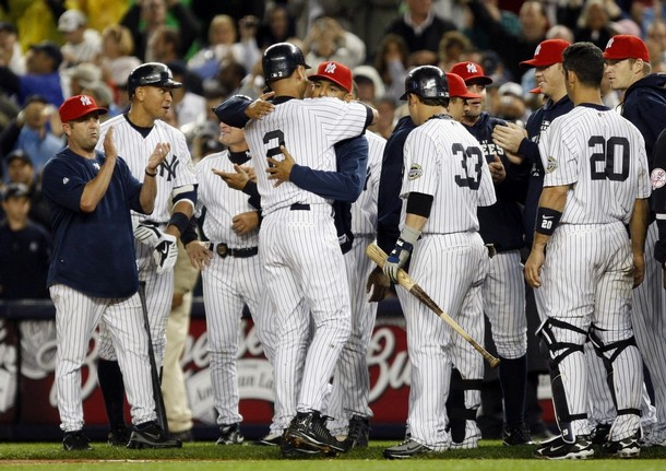 Jeter's teammates come out to congratulate him and to give him a hug.