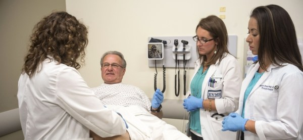 Teaching associates use their bodies to guide med students ...