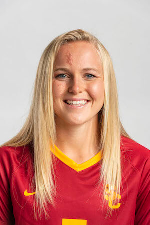 Penelope Hocking photographed in a headshot style photo, wearing a USC soccer uniform. Penelope is smiling and looking into the camera.