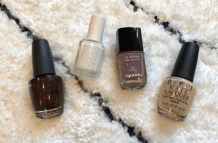photo of nail polish bottles on white carpet