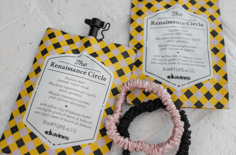photo of two packets of the Davines Renaissance Circle hair mask and two silk hair ties