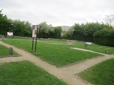The paths mark the line of the preserved WWI dugout beneath the ground